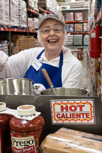 Barbara handing out samples of Prego Pasta Sauce at Costco.